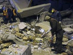 Rescuers search for survivors in the rubble of a collapsed hotel in Van, Turkey, late Wednesday.