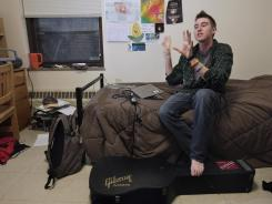 Austin McKenney, 18, lives on one of the gender-neutral dorm floors at Grinnell College in Iowa. This fall, the progressive private liberal arts college added a gender-neutral locker room to its mix of gender-neutral campus options