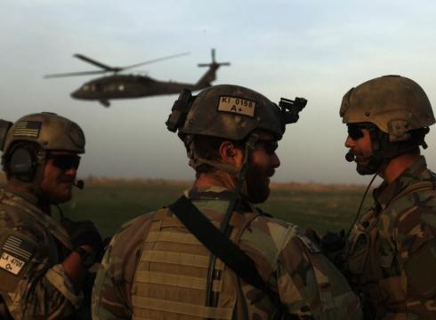 Army Special Forces guard a landing zone last year in Marjah ...