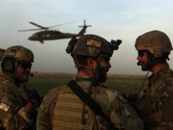U.S. Army Special Forces guard a landing zone last year in Marjah, Afghanistan.