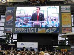Gov. Scott Walker, at Miller Park in Milwaukee on Wednesday, said Ohio's anti-union law hadn't been implemented yet, as it is in Wisconsin, so voters there never got to see how well the reforms work.