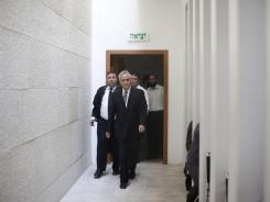 Former Israeli President Moshe Katsav enters the courtroom at the Supreme court in Jerusalem on Thursday.