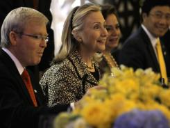 U.S. Secretary of State Hillary Clinton, center, sits with Australian Foreign Minister Kevin Rudd, left, and Mexican Foreign Minister Patricia Espinosa during a dinner with APEC finance ministers at the Asia-Pacific Economic Cooperation summit Thursday in Honolulu. Vietnam Foreign Minister Pham Binh Minh is at far right.