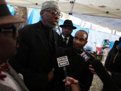 Imam Abdullah Bey El-Amin, center, speaks Wednesday during a a news conference in Detroit about local clergy members plans for a march and prayer rally in response to the 24-hour Christian event known as TheCall.