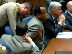 Dr. Conrad Murray is remanded into custody after the jury returned with a guilty verdict in his involuntary manslaughter trial in Los Angeles on November 7.