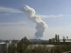 In this image taken from amateur video, smoke rises from an explosion at a Revolutionary Guard ammunition depot outside Bidganeh village, west of Tehran, on Saturday.