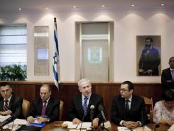 Israeli Prime Minister Benjamin Netanyahu attends the weekly cabinet meeting Sunday in his Jerusalem office.