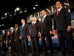 Republician presidential hopefuls, from left to right, Jon Huntsman, Michele Bachmann, Ron Paul, Herman Cain, Mitt Romney, Newt Gingrich, Rick Perry and Rick Santorum participate in the South Carolina Presidential Debate at Wofford College.