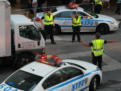 NYPD police officers direct a van to pull over at a checkpoint near Times Square on September 12.