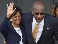 In this May 21, 2011 photo, Gloria Cain, left, accompanies her husband Herman Cain as he announces his run for the Republican presidential nomination in Atlanta.