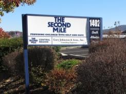 Second Mile CEO Jack Raykovitz resigned Sunday after a grand jury brought molestation charges against the charity's founder, former Penn State assistant football coach Jerry Sandusky.