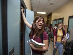 Diana Lopez, 17, left, gets books out of her locker in April 2010 at Hancock High School in Chicago.