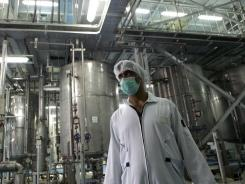 Near the capital : An Iranian technician works at a uranium conversion facility near