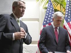 House Speaker John Boehner of Ohio, left, and House Majority Whip Kevin McCarthy, R-Calif., wait to speak to the media on Capitol Hill on Tuesday.
