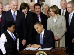 March 23, 2010:  President Obama signs health care law.