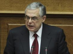 Greek Prime Minister Lucas Papademos delivers a speech at  Parliament in Athens.