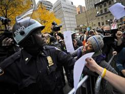 Demonstrators from the Occupy Wall Street movement wave court orders to reopen Zuccotti Park.