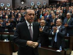 Turkey's Prime Minister Recep Tayyip Erdogan leaves after addressing members of Parliament regarding the crisis in Syria.