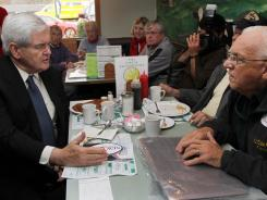 GOP presidential candidate Newt Gingrich, left, wrote about issues pushed by his think tank clients.