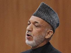 Afghan President Hamid Karzai called on elders assembled for a national conference Wednesday to help create a fair framework for relations with the U.S.