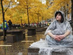 Protester Jorden Eck sits in Zuccotti Park in Manhattan a day after it was cleared of Occupy Wall Street activists.