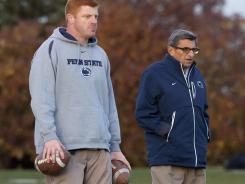 Penn State assistant coach Mike McQueary and former head coach Joe Paterno.