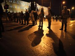 Riot policemen guard the Greek Parliament during Thursday's protest in Athens.