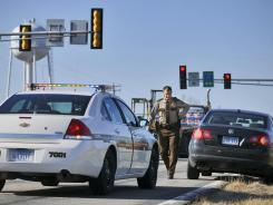 Benton County (Minn.) Sheriff's Deputy Garth McFadden makes a traffic stop in Foley. Currently the City of Foley contracts with Benton County to provide policing services.
