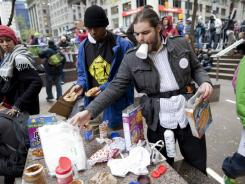 Occupy Wall Street protesters prepare food after they re-entered Zuccotti Park in New York on Thursday.