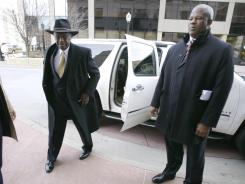 Republican presidential candidate Herman Cain arrives at a campaign stop Tuesday  in Dubuque, Iowa.