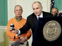 New York Police Commissioner Raymond Kelly shows a model of a pipe bomb with Mayor Michael Bloomberg, left.