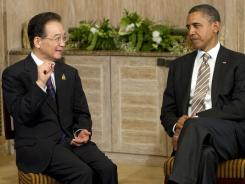 President Obama listens to Chinese Premier Wen Jiabao during a sideline meeting Saturday. Talk of territorial disputes was off-limits.