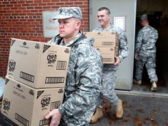 Kentucky National Guard members Sgt. first class Joshua Settles, left, and Lt. Mark Slaughter load up food donations from Kraft to take to Frankfort as part of the Christmas Angel program.