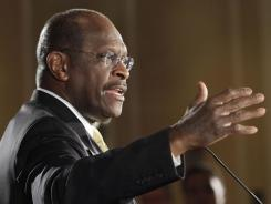 Republican presidential candidate Herman Cain speaks during a rally with supporters in Nashua, N.H.
