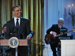 President Obama speaks during an event celebrating country music November 21 in the East Room of the White House.