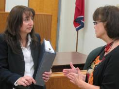 Sandra Smith, left, an attorney for a Tennessee woman who sent her adopted son back to Russia, speaks to Holly Spann, a Tennessee representative for the American Adoption Congress, after a Nov. 21 hearing related to the adoption dispute.
