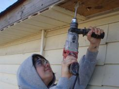 Amber Kuth, with AmeriCorps' National Civilian Community Corps, helps rebuild a house as part of a team effort with the Lower Nine volunteer group.