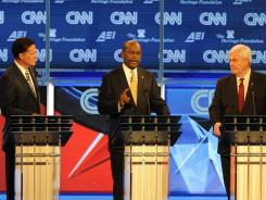 Mitt Romney, Herman Cain and Newt Gingrich participate in Tuesday's Republican debate.