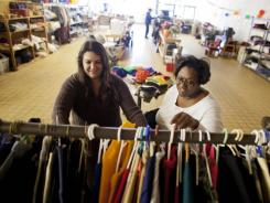 Volunteer Alison Conner, left, helps Martha Nicks, who works for the Girl Scouts, shop at the free store. People are limited to three items per visit.