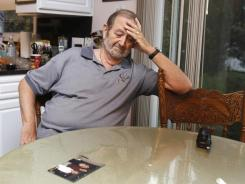 Jack Kern, father of Timothy Kern, looks at a photo of his missing son in the kitchen of his Massillon, Ohio, home.