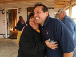 Homeowner Sherrel Clark of Smithville, Miss., embraces Eight Days of Hope co-founder and president Steve Tybor.