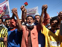 Yemeni protesters shout anti-regime slogans during a demonstration in Sanaa on Nov. 12.