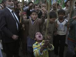 A Pakistani boy shouts slogans along with other protesters during a rally to condemn NATO helicopters attacks on Pakistani troops, on the outskirts of Islamabad, Pakistan, on Sunday.