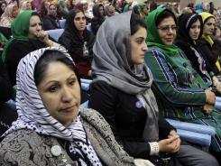 Delegates listen to a speech by Afghan President Hamid Karzai on the last day of Loya Jirga or grand council in Kabul on Saturday.