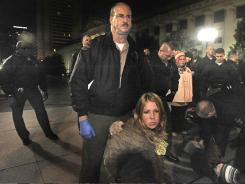 Occupy Nashville protester Lindsey Krinks is arrested by state police during a raid on Legislative Plaza in October.
