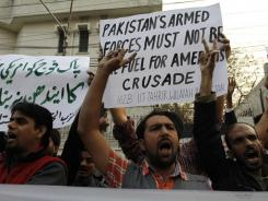 Pakistani protesters rally to condemn a NATO airstrike on Pakistani troops Sunday in Lahore, Pakistan.