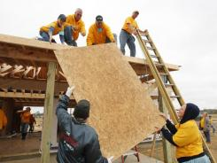 Eight Days of Hope volunteers construct a home on Nov. 4 on the site of one destroyed by a tornado in the town of Smithville, Miss. Charitable giving could take years to return to pre-recession levels, non-profit leaders say.