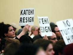 Protesters urge UC Davis chancellor Linda Katehi to resign during an on-campus meeting.