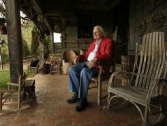 Rev. Billy Graham sits on the porch of his mountaintop cabin in Montreat, N.C.