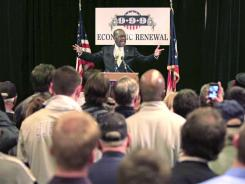 Republican presidential candidate Herman Cain speaks to supporters during a rally Wednesday in Dayton, Ohio.